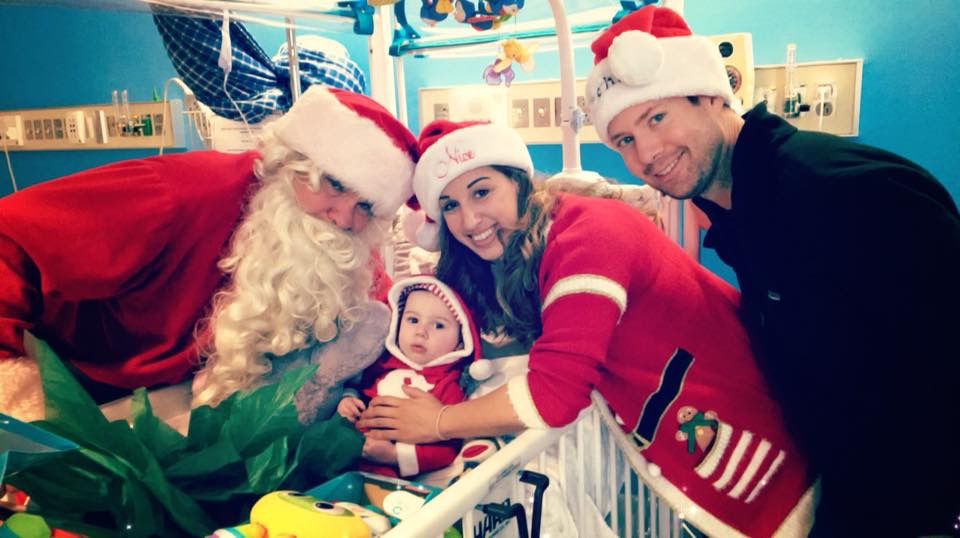 Grant with parents Liza and Sam (and Santa) at Shriner's Hospital, Christmas 2017