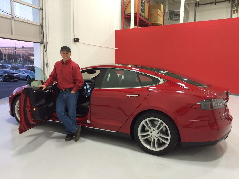 eMotion founder Joe Edgell takes delivery of our first Tesla Model S
