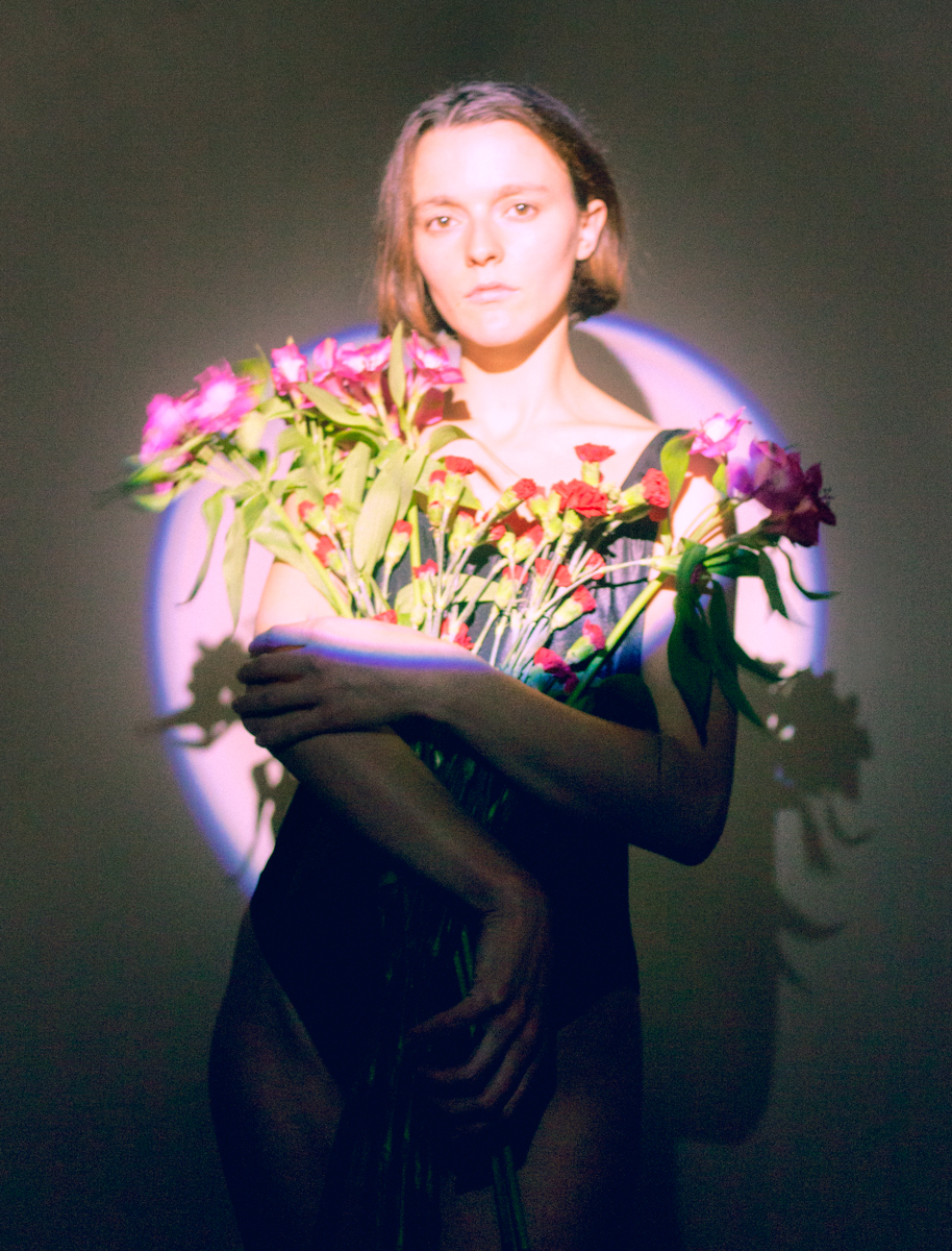 mo with flowers in spotlight.jpg