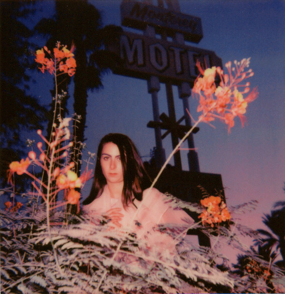 Polaroid of Cara in front of the Monterery Motel