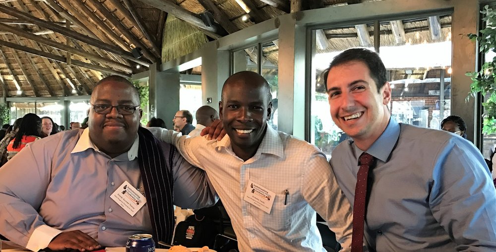 Thomas Kisimbi (left), Kiribakka Tendo (middle), and Matt Ramirez (right) spent time together at the Institutionalizting Community Health Conference in South Africa.