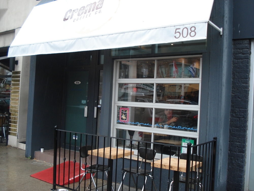 Picture of exterior of coffee shop. Red StopGap ramp outside of door
