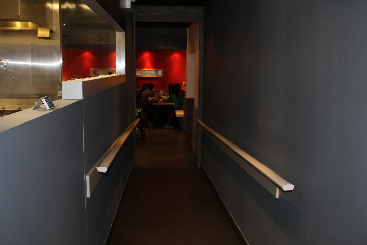 Picture of accessible hallway with hand rails.