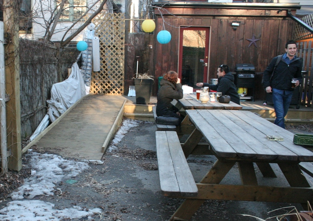 Picture of accessible patio seating and ramp.