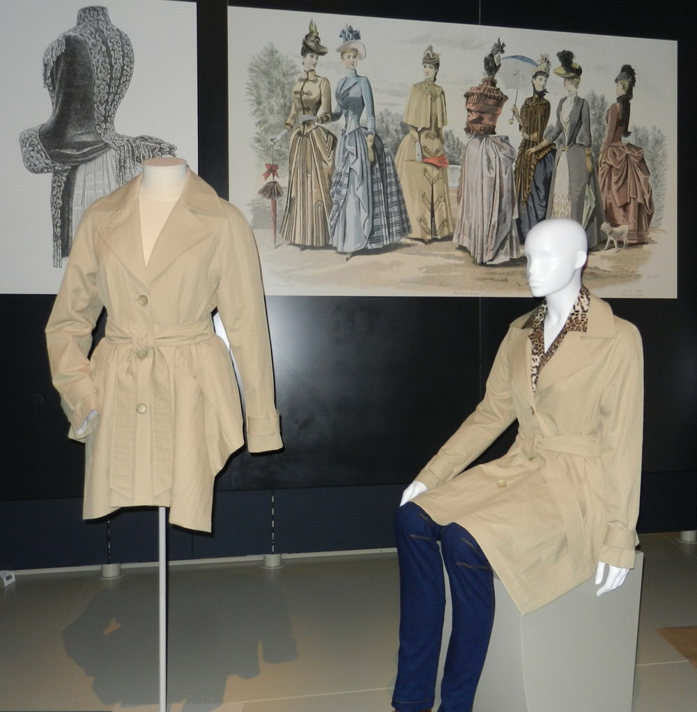 Picture of a mannequin wearing a beige trench coat.