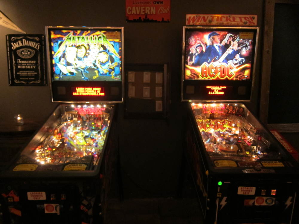 Picture of two vintage arcade games.