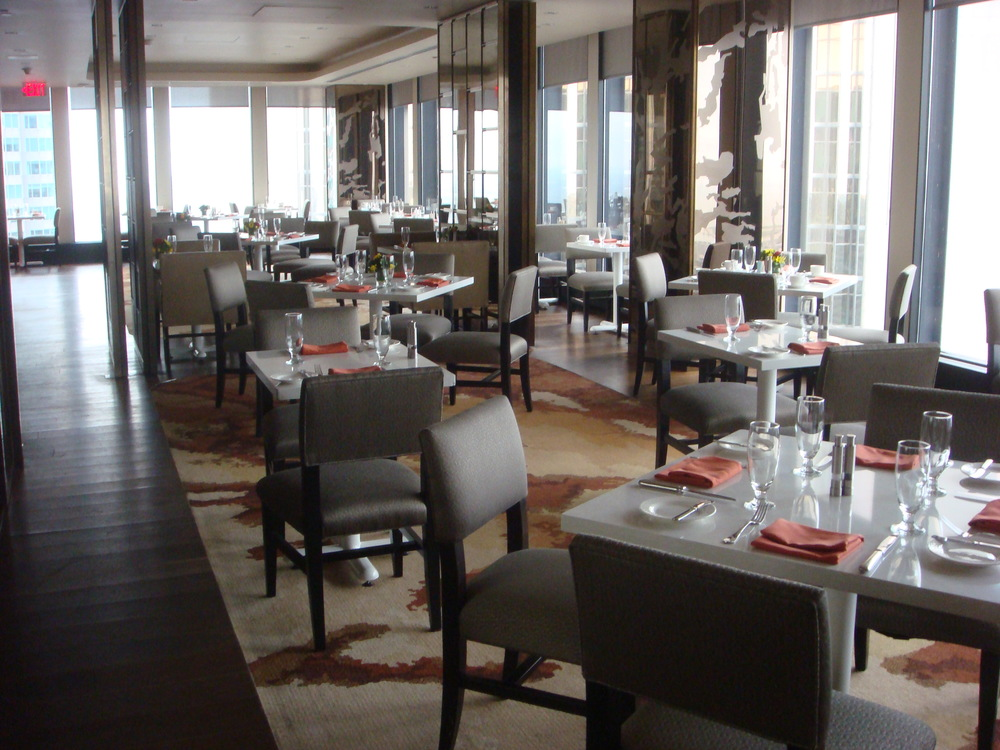Picture of accessible interior of restaurant. All standard height tables.