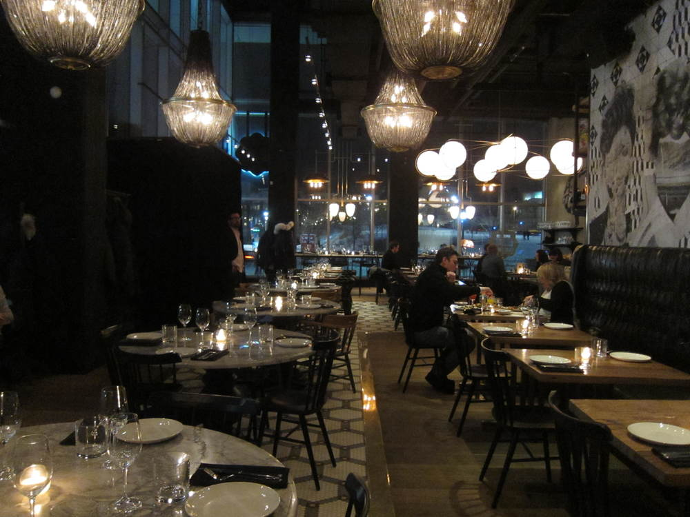 Picture of accessible interior of restaurant. Dim lighting.