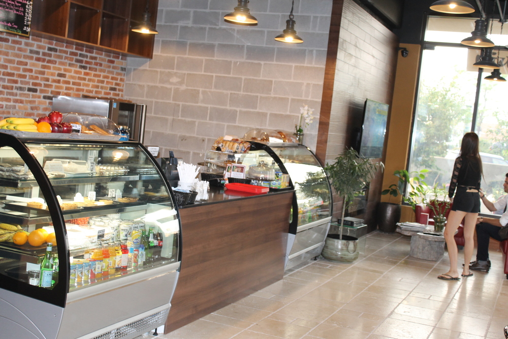 Picture of large interior of cafe showing dessert bar