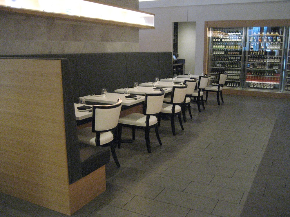 Picture of tables and benches within the large dining space