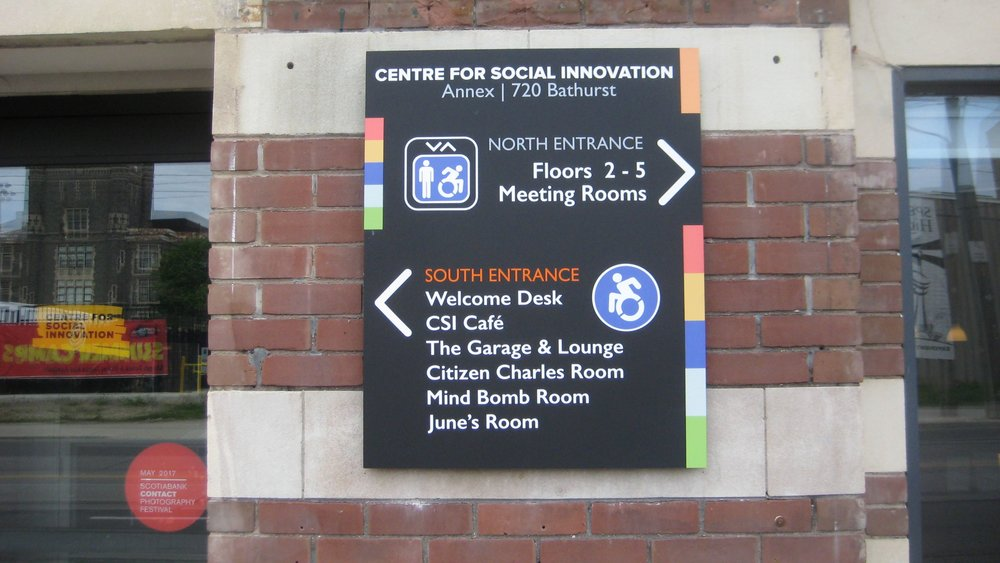 Picture of the way finding sign at the front of the building regarding accessibility features