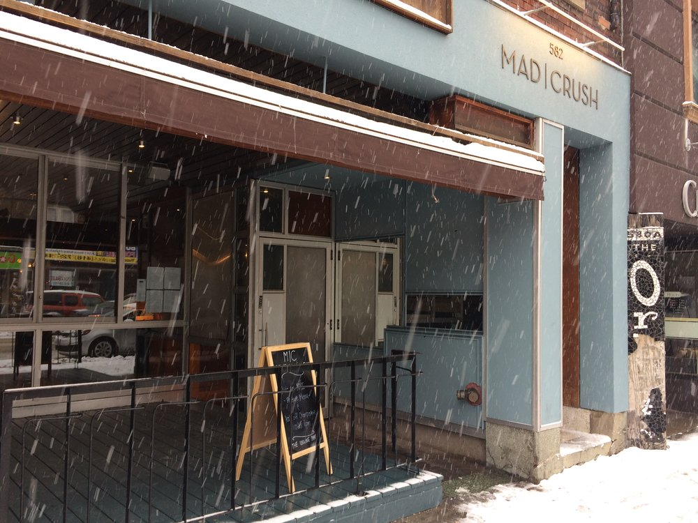 Picture of accessible exterior of Mad Crush. It is snowing.