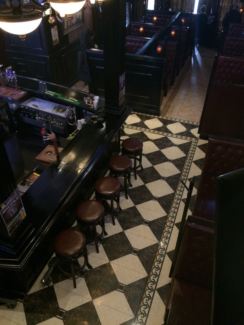 Picture of variety of seating options at the Lucky Clover Pub