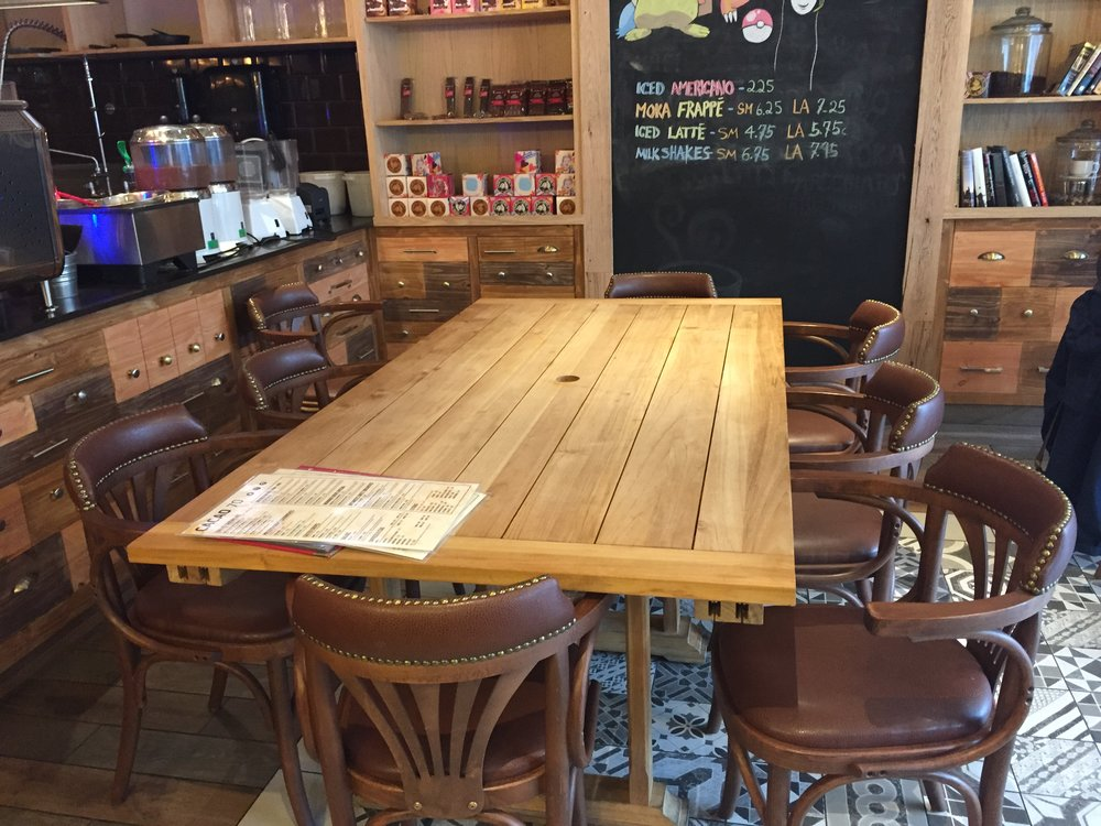 Picture of large standard height table with chairs at Cacao 70