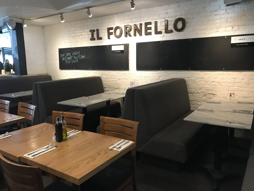 Picture of standard height table and booth seating at Il Fornello