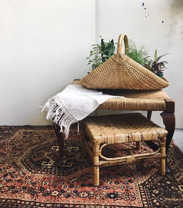layers of natural fibers: beautiful 1930's square ottoman ($125), rattan footstool ($29), and 3x5' persian wool rug ($268).