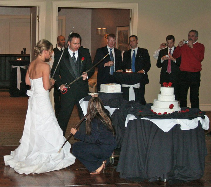 Yes. They DID cut their cake with their swords!!!