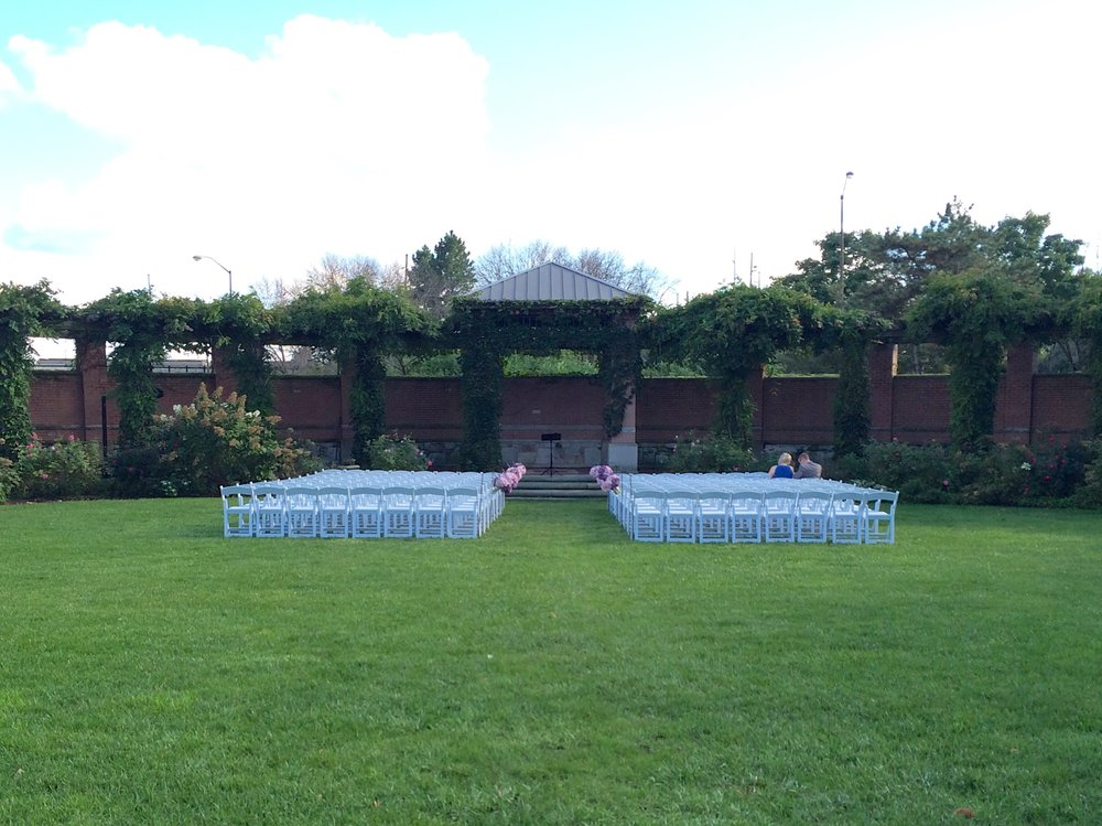 Indianapolis Zoo Efroymson Wedding Garden set for Jenae & Chad - the rain stopped, the clouds parted and the sun shone!