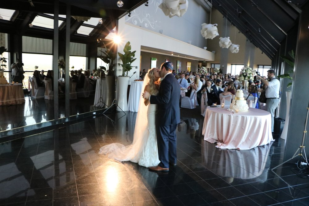 "After signing their ketubah then their wonderful ceremony, Carrie & Kyle danced to ""Crazy Love"""