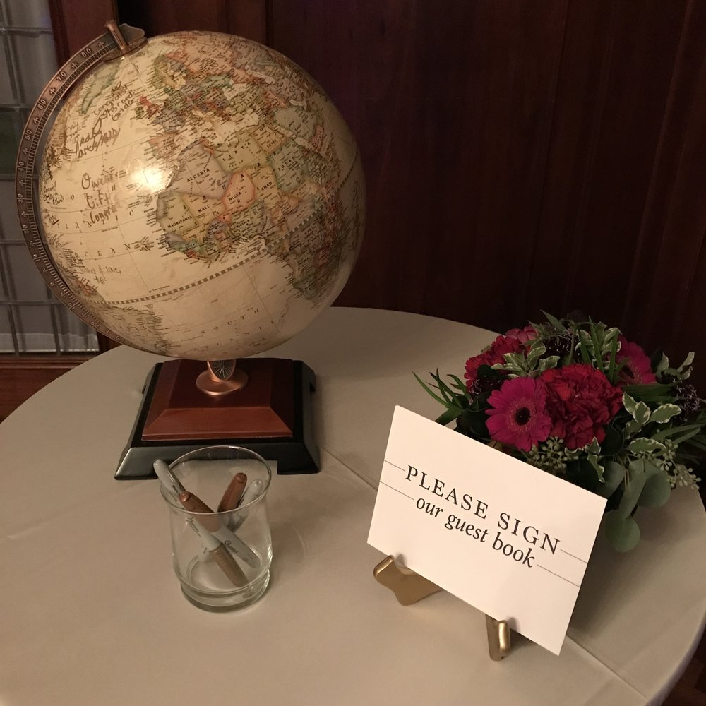 At the door, friends were asked to sign their guest book Globe!