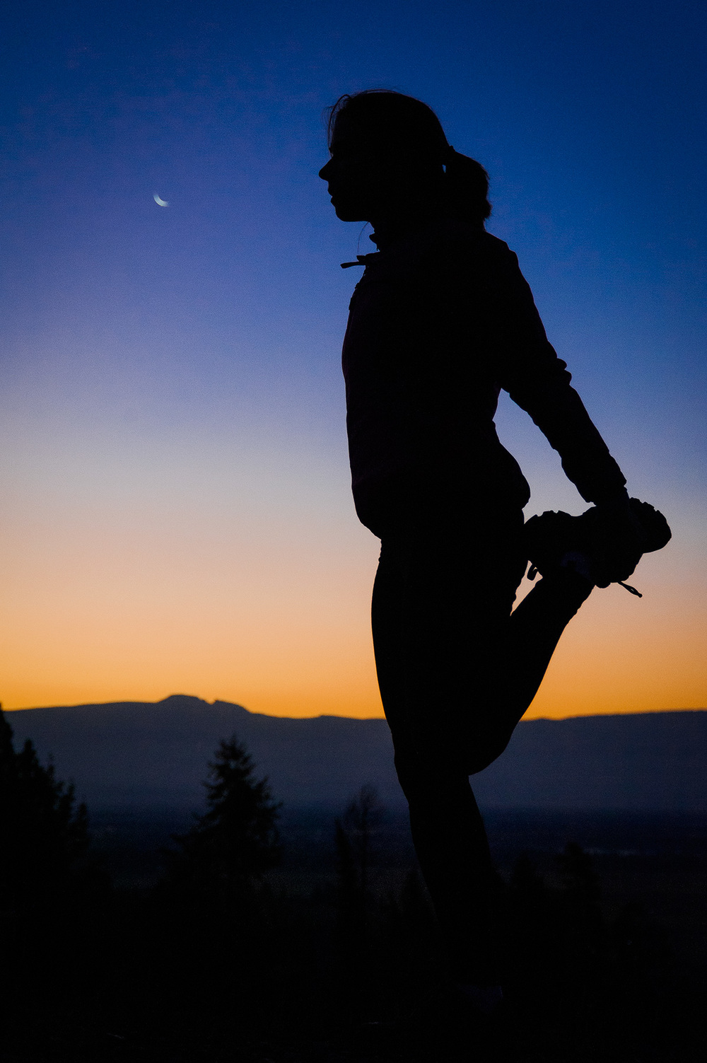 North Face athlete Kit Deslauriers stretching at sunrise in Jackson, WY