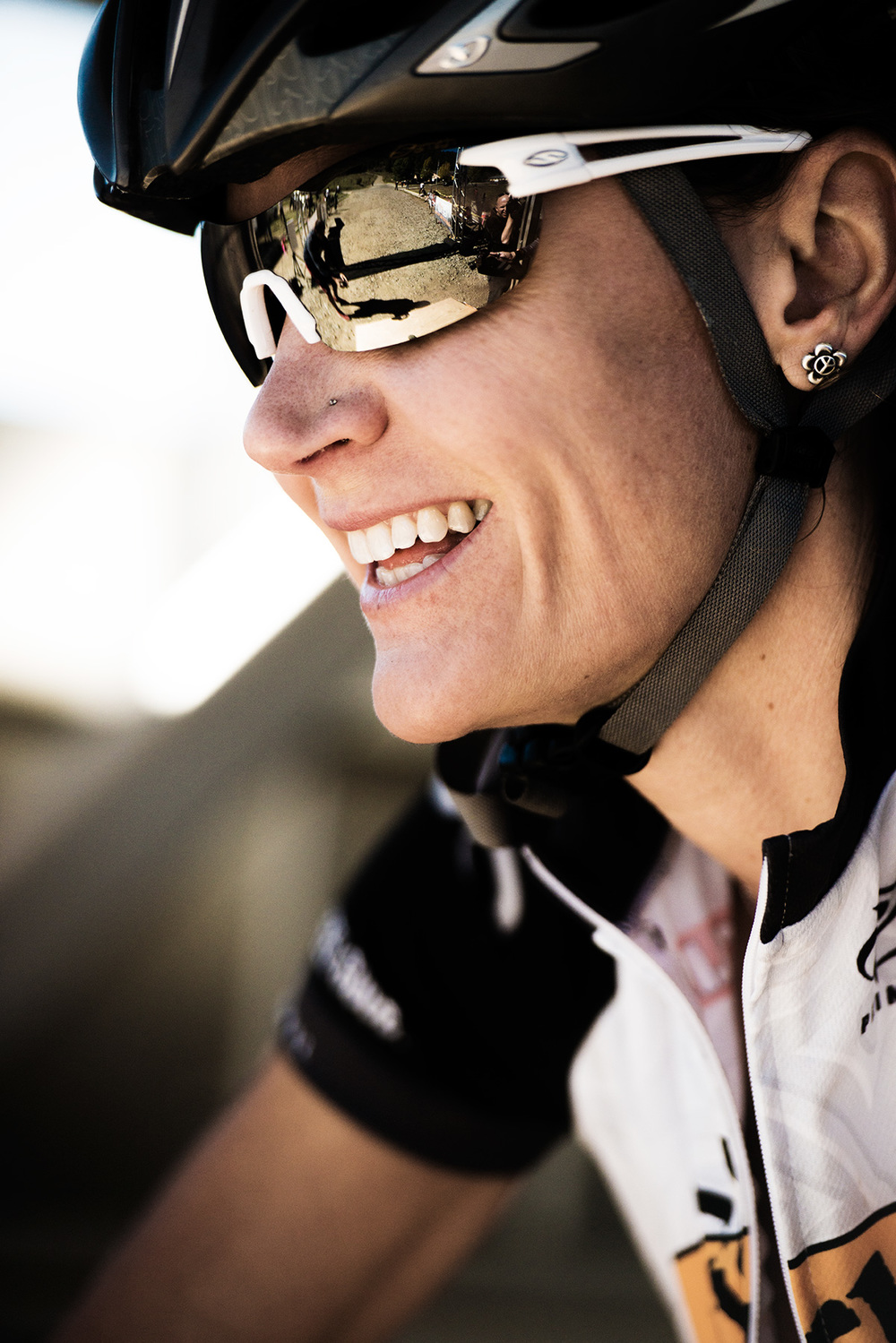 A female cyclist prepares for the GECKO Epic race