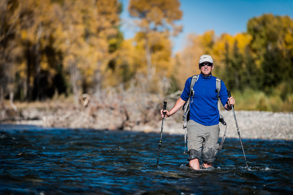 Adventurer Forrest McCarthy crossing a river near Jackson, WY