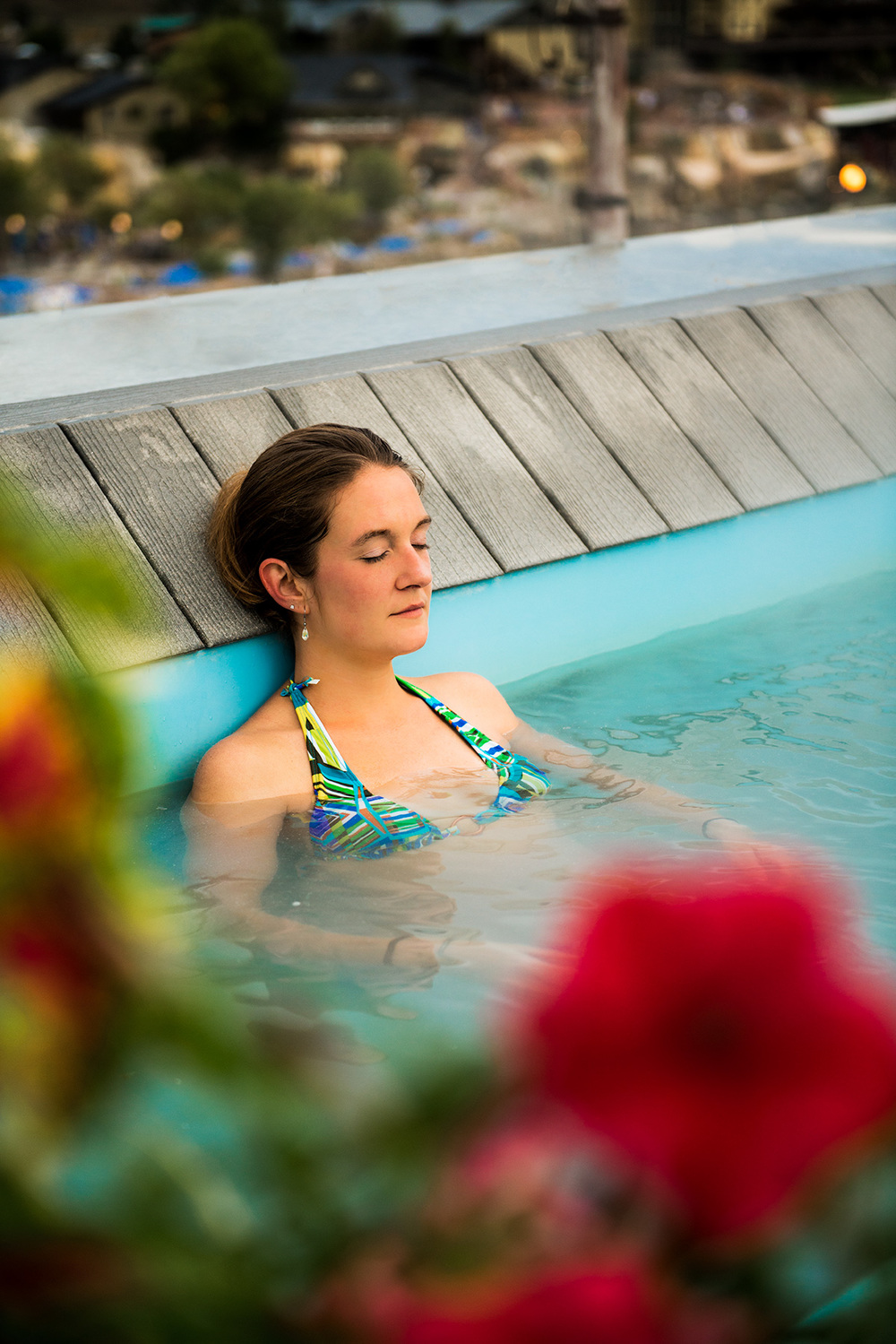 Advertisng image of a woman soaking in a rooftop hot spring in Pagosa Springs, CO