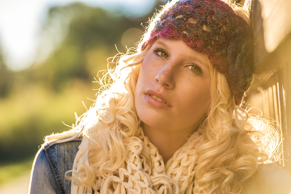 Fashion advertising photo of a teenage girl in a handmade headband and scarf during sunset