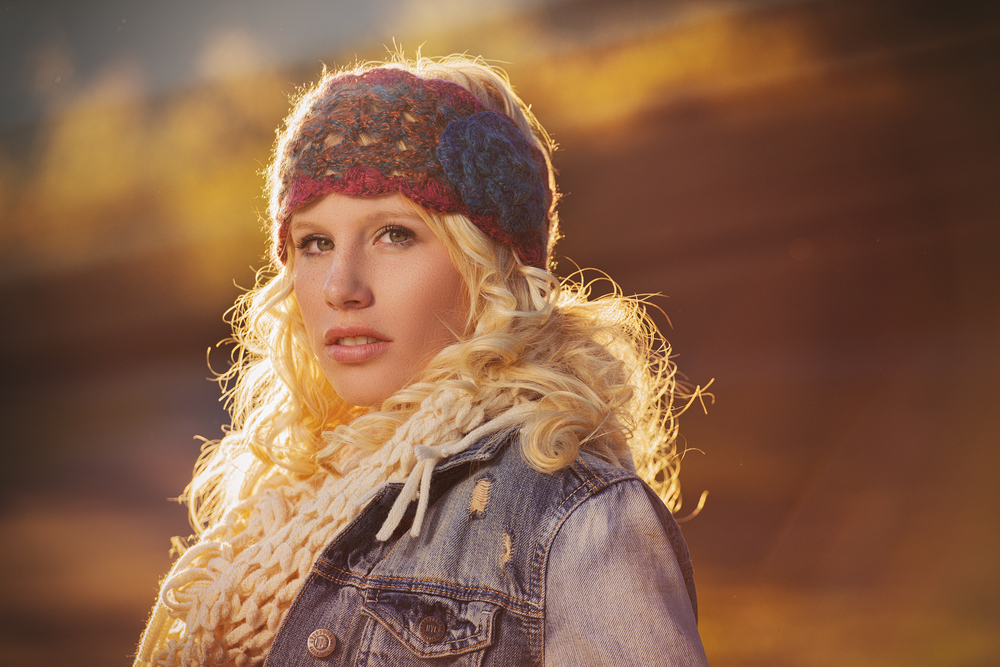 Fashion editorial portrait of teen girl in a fall sunset