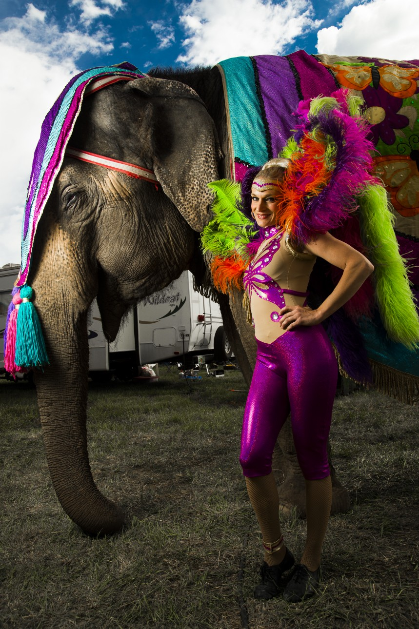 Backstage photo of circus perfomer with an elephant