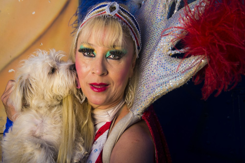 Backstage photo of circus perfomer with a dog
