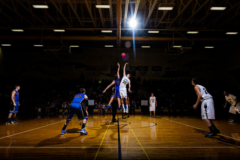 Creative arena lighting at the tipoff of a high school basketball playoff game