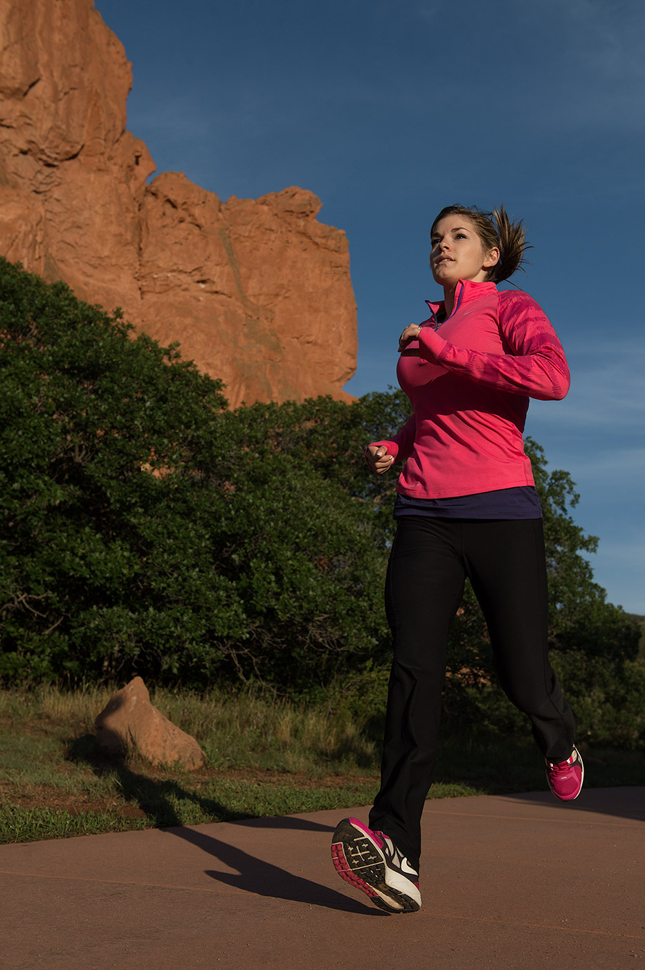 A female athlete run in the Garden of the Gods near Colorado Springs, CO