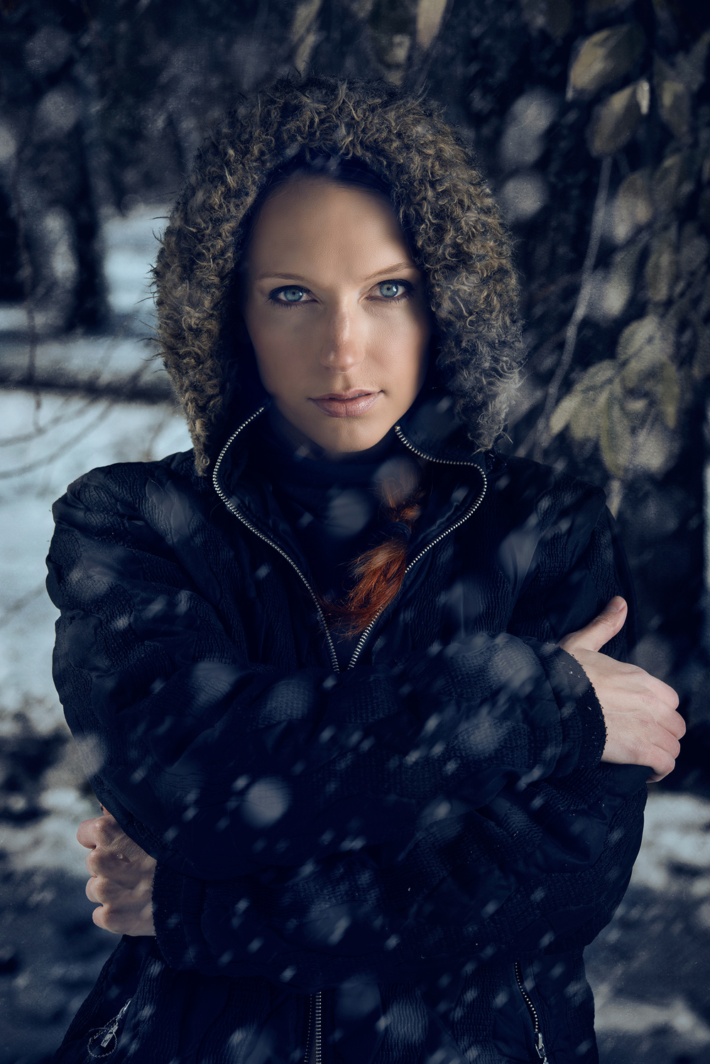 A female model poses in a winter jacket in Denver, CO