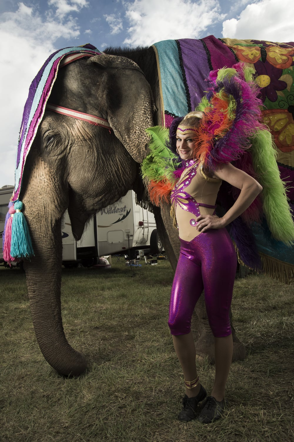 Portrait of a female circus performer with an elephant