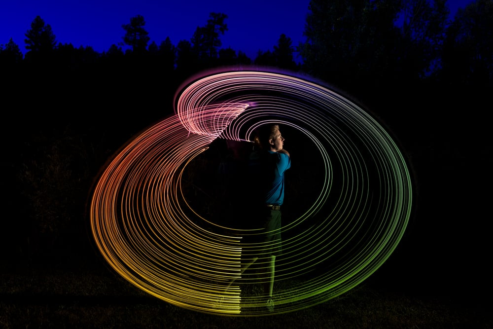 Creative lighting image of a golfer combining strobes and LED lights
