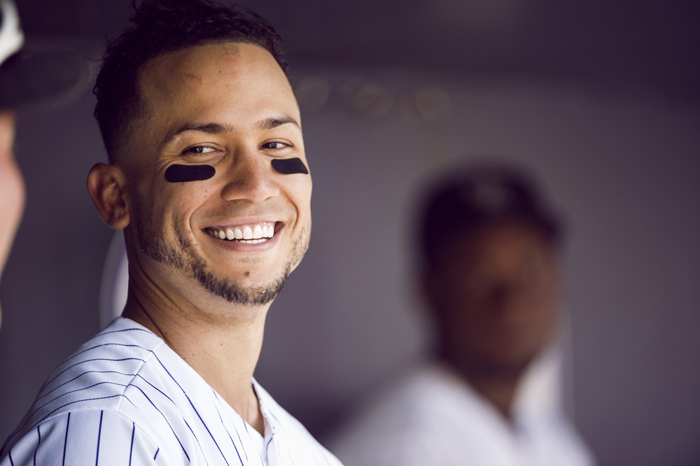 Colorado Rockies' outfielder, Carlos Gonzalez, smiles after a homerun