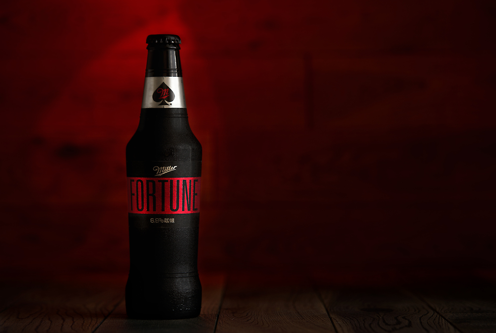 Studio product photo of Miller Fortune Lager beer with spade backlight