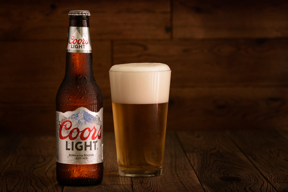 Studio product photo of Coors Light with an American Flag Reflection in the glass
