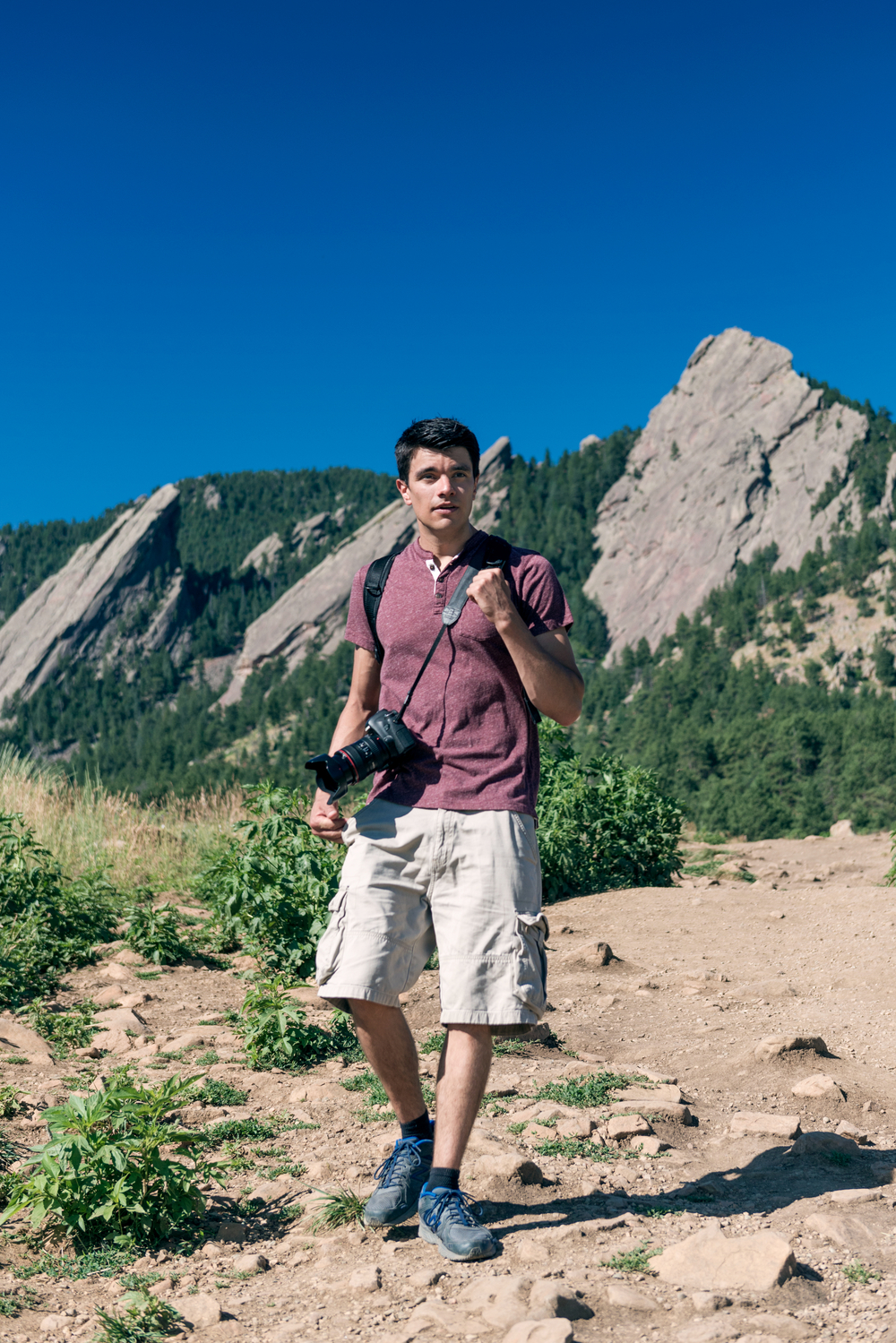 Advertisng image of male model with camera at the Flat Irons in Boulder, CO