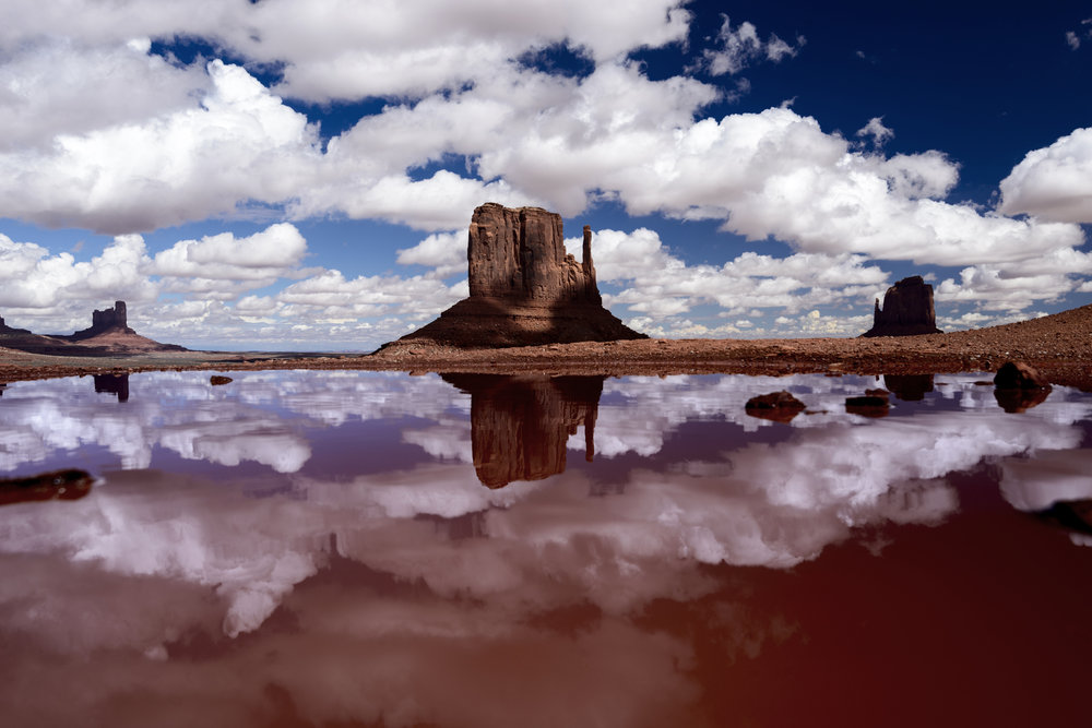 Monument Valley reflection with clouds