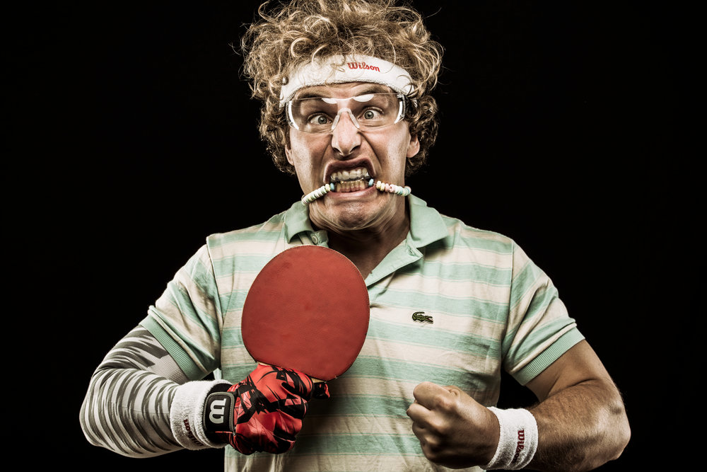 Crazy ping pong and table tennis player portrait