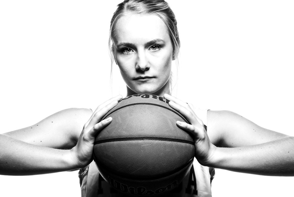 Black and White, high-key portrait of female basketball player