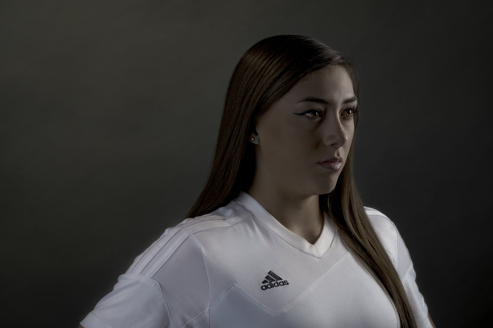 Female athlete in Adidas soccer jersey