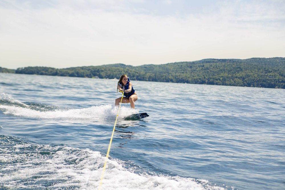 WaterSports   - Lake George We love to take our guests out on our speedboat, Theora, and drop them off on one of the 170-odd islands on Lake George. Once we have dropped off some of the group to have a picnic on the island overlooking the lake, we take the others waterskiing, wakeboarding and tubing. Opposite the Sagamore Hotel, there's a great cliff jumping spot for the brave. The water is warm from June to September and even into October some years. In May the water is fairly cool but with a wetsuit you'll be just fine.