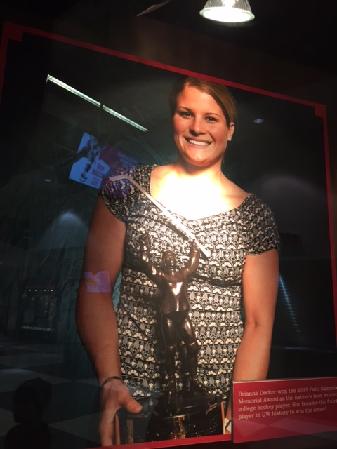 This display portrays Brianna Decker, a UW alumna who, in 2012, won the Patty Kazmaier award for best female NCAA Division 1 hockey player. She currently plays for the Boston Pride in the NWHL. She is also on the U.S. national team.