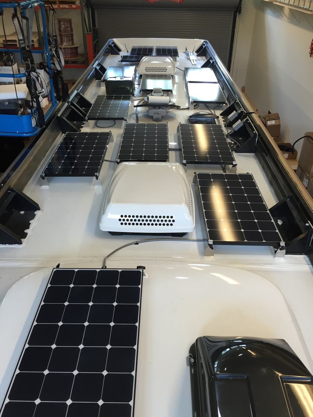 Equipment Added: 14x  SP100 Solar Panel Kits  (1,400W of Solar) 1x  Roof Box  1x Victron BlueSolar MPPT150/100-Tr 1x  Victron MPPT Control Monitor  1x  Victron BMV-702