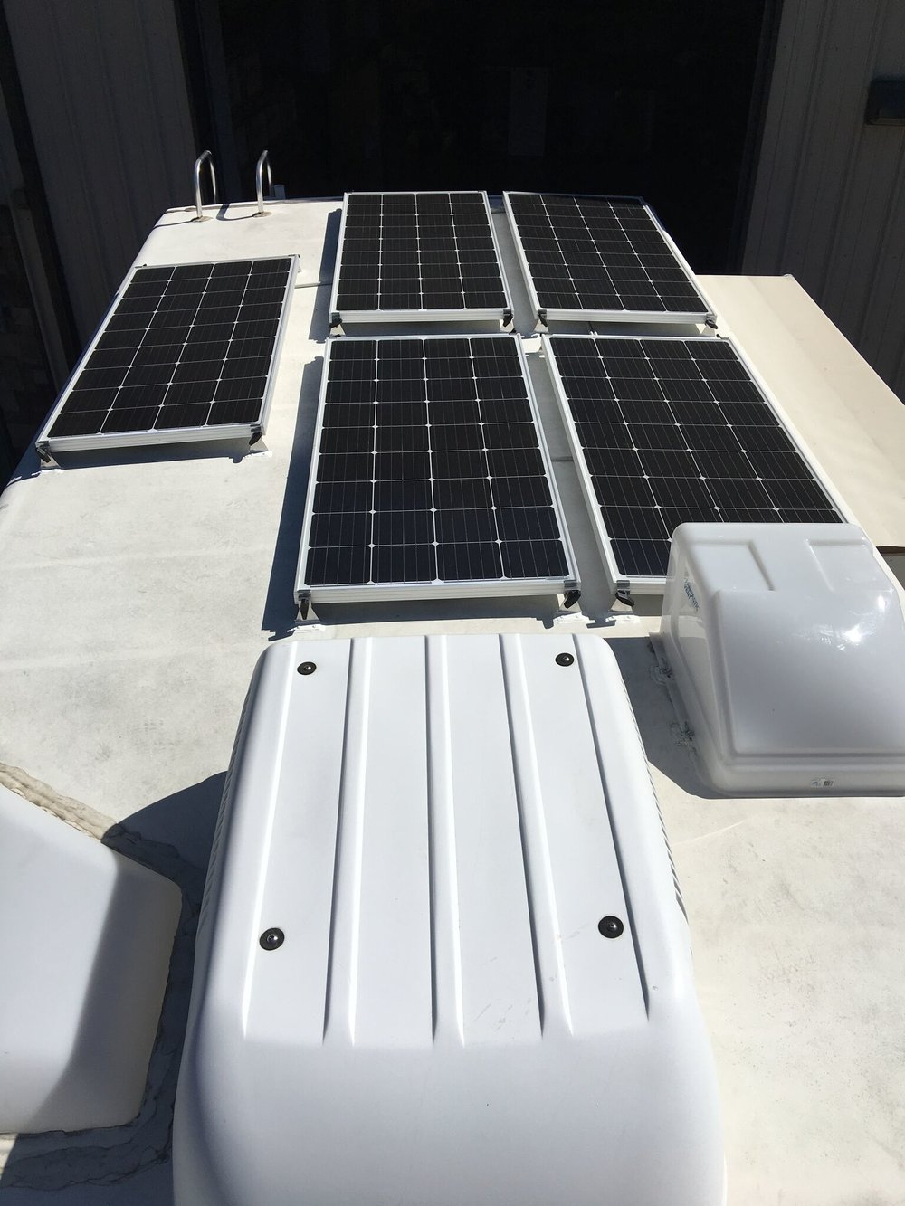 Equipment Added:  5x SF180 Solar Panel Kits 1x Roof Combiner Box 1x Victron BlueSolar Smart MPPT 100A Charge Controller Core 1x 3000VA Victron MultiPlus Inverter Kit 1x Color Control Monitor 4x 400Ah AGM GPL L16s 6V Batteries 1x Easy Start