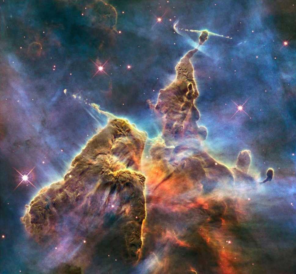 "Image Credit: NASA, ESA, and M. Livio and the Hubble 20th Anniversary Team (STScI)   This image of the Carina Nebula captures ""the top of a three-light-year-tall pillar of gas and dust that is being eaten away by the brilliant light from nearby stars. The pillar is also being pushed apart from within, as infant stars buried inside it fire off jets of gas that can be seen streaming from towering peaks like arrows sailing through the air.""  Viewed with the naked eye, this nebula, which has already given birth to over 14,000 identified stars, is just a pinpoint in the sky. The reality of our true nature, and that of our universe, is more amazing, more awe-inspiring, than anything we could possibly invent in our imagination."